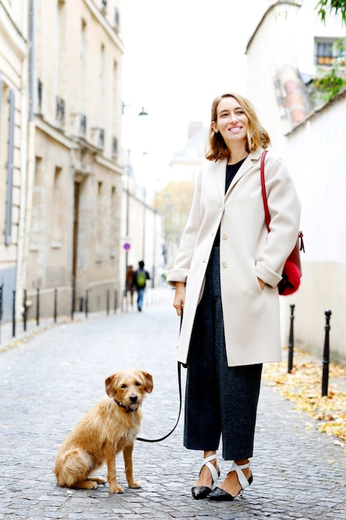 """""""With my dog Kochka, wearing a coat and pants from Acne Studios, bag from Fendi and shoes from Louis Vuitton."""""""