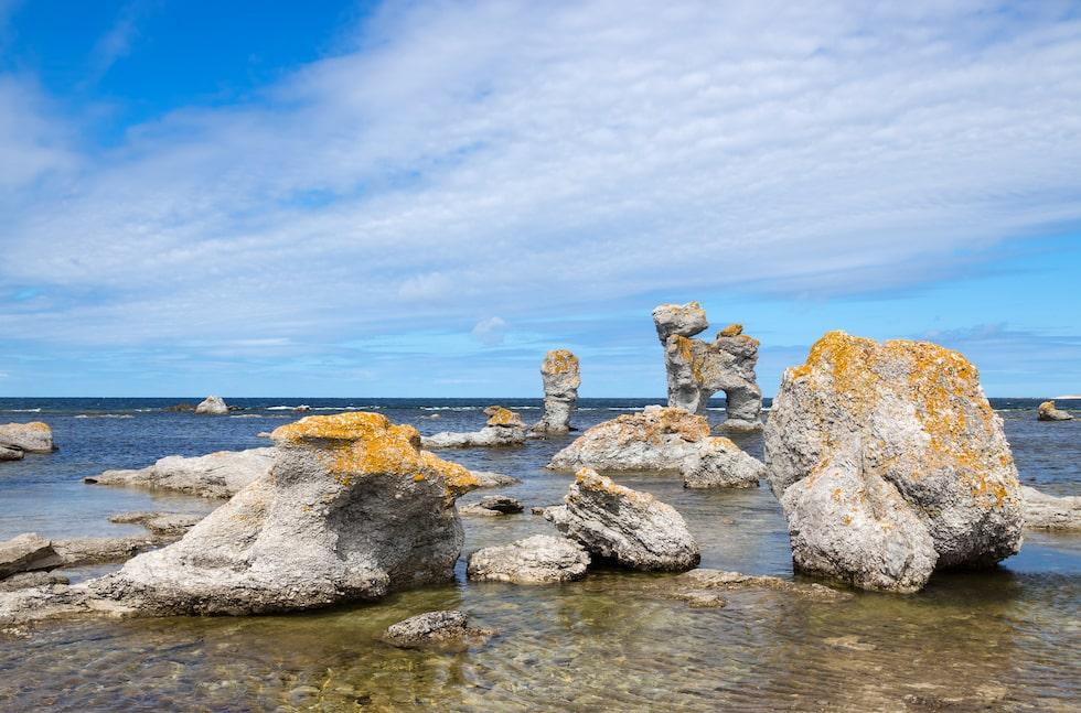 "Limestone formations on Fårö island in Gotland, Sweden. These rocks are called ""raukar"" in Swedish."