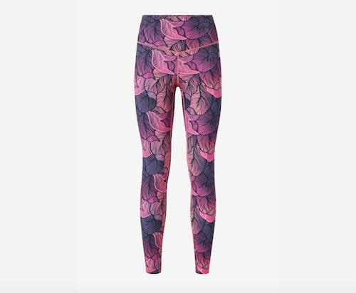 Rosa-lila träningstights med mönster.