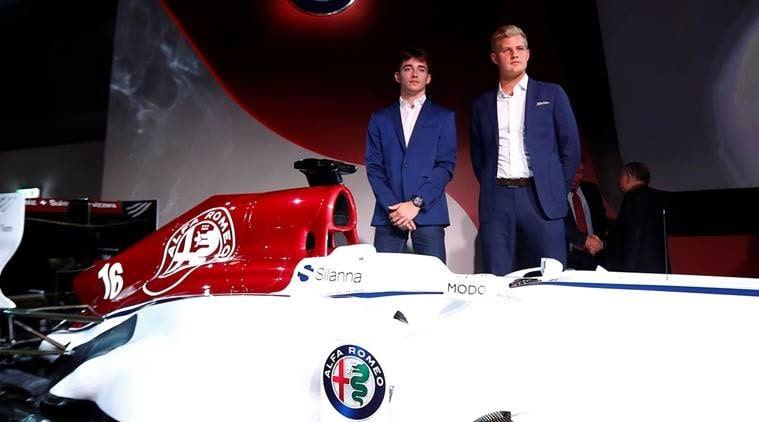 Drivers Charles Leclerc of Monaco (L) and Marcus Ericcson of Sweden pose next to the Alfa Romeo Sauber F1 car during a presentation in Arese, near Milan, Italy December 2, 2017. REUTERS/Alessandro Garofalo