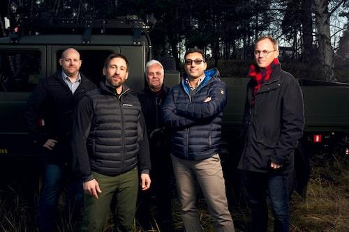 Jörgen Ericsson (kvalitet), Stefan Källman (konfiguration), Patrik Stedt (fordonsexpert), Per Robertini (projektledare) och Olof Berg (controller). Fem av FMV:s Tgb 14/15-specialister.