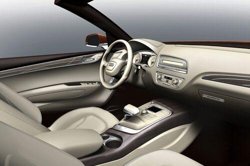 Notera MMI-skärmens placering framför växelväljaren. Mitt i förarens blickfång enligt Audi. Knappast!