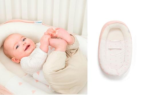 I ett babynest ligger bebisen säkert.