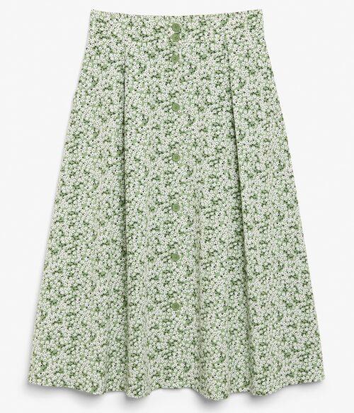 Klockad blommig kjol från Monki med knappar fram. Klicka på bilden och kom direkt till kjolen.
