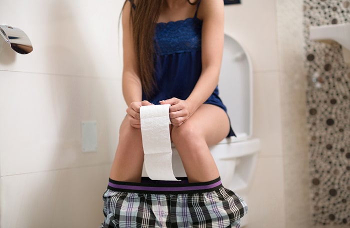 Girl on morning toilet