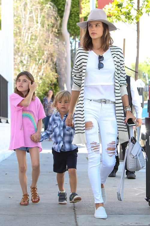 Beverly Hills, CA - Alessandra Ambrosio arrives with her children Anja and Noah, for lunch at Au Fudge in West Hollywood. Alessandra dressed in spring colors with an all white and black striped ensemble as she led her adorable kids into the celeb-owned restaurant with a shabby-chic vibe, Cal-French menu, cocktails and a monitored kids playroom. AKM-GSI March 29, 2016 To License These Photos, Please Contact : Steve Ginsburg (310) 505-8447 (323) 423-9397 steveakmgsi.com salesakmgsi.com or Maria Buda (917) 242-1505 mbudaakmgsi.com ginsburgspalyincgmail.com