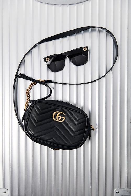 """""""Väska och solglasögon från Gucci."""""""
