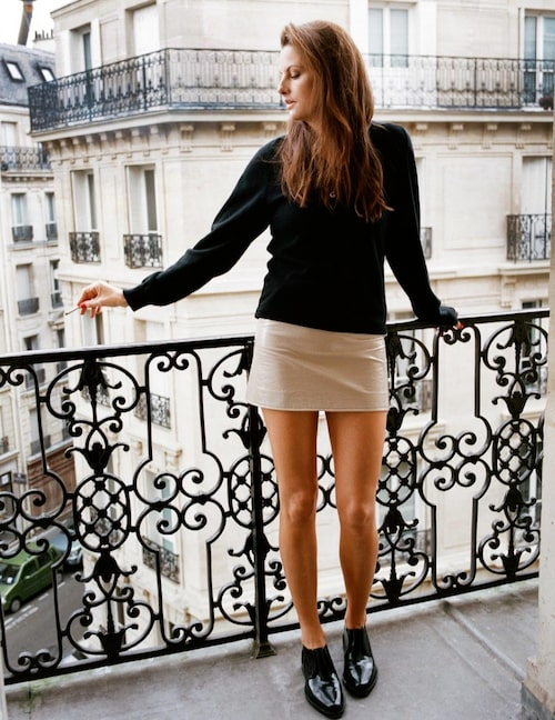 Cashmere sweater from Saint Laurent, skirt from Courrèges and shoes from Paco Rabanne.