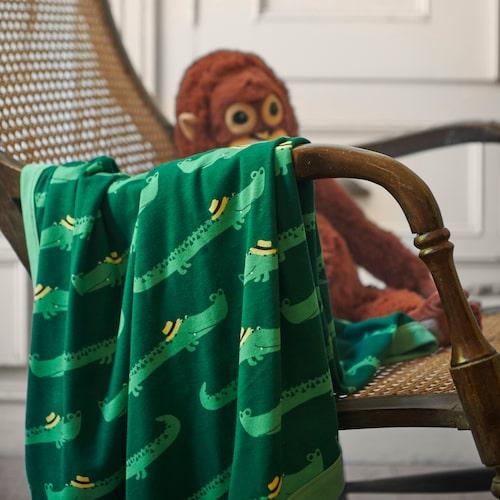 Babyfilt med krokodil-mönster,i serien Rörande.