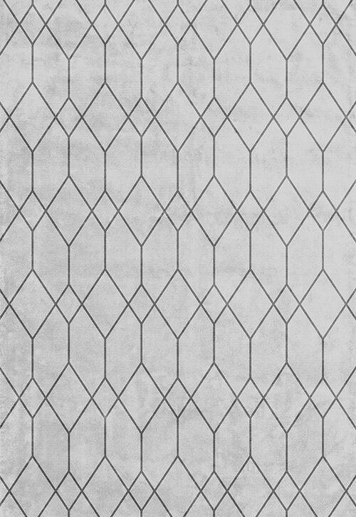 Med en matta på golvet, lugnar du ner och skapar rum i rummet. Denna från Layered.