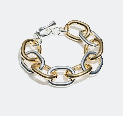 Länkat armband i två metaller från Glitter. Klicka på bilden och kom direkt till armbandet.