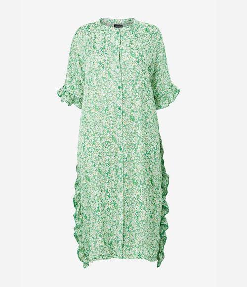 Grön omlottklänning.