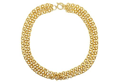 Ett guldhalsband passar fint till vårens färgglada look.
