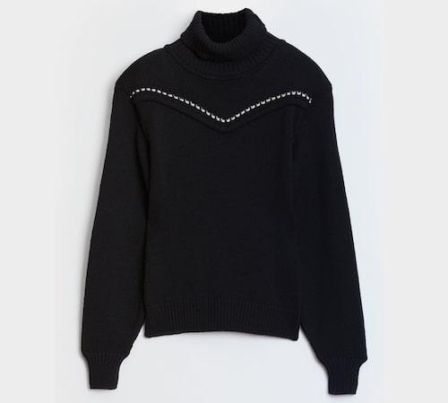 Stickad tröja i merinoull, från Rodebjer.