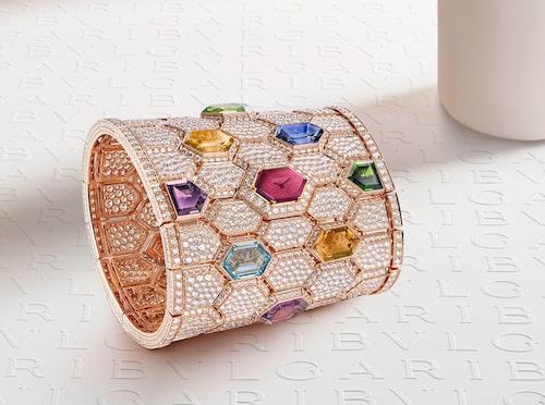 Ur-manschett i guld helt  överhöljd med diamanter och ädelstenar från Bvlgari