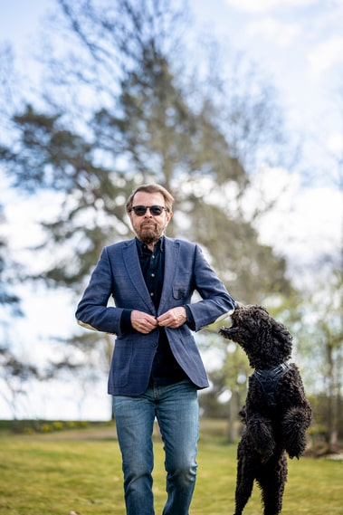 Björn Ulvaeus exercises regularly to keep fit. Here he is with his dog, Ares.